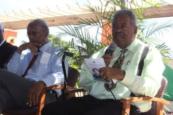 The late Hon Ralph T. O'Neal, OBE speaking at the Opening and Naming ceremony for the Walters Recreational Park in Valley, Virgin Gorda on December 19, 2013. Left is then Premier Dr D. Orlando Smith. Photo: VINO/File