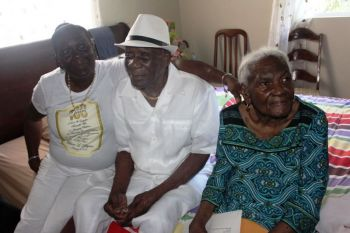Mrs Josephine Rhymer (right), with her husband William I. Rhymer and daughter Shirley (left) back in November 2016. Photo: VINO/File