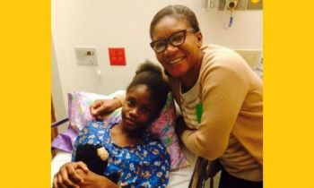 T'Shonda Dore getting some love from her grandmother Ms Vera Meade while settling in at the Shriners Hospital for Children in the United States recently. Photo: Provided