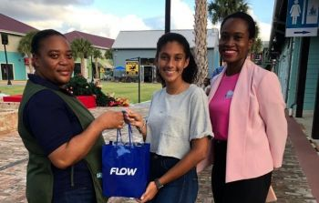 Raffle winner Freena McDonald (left) is presented with her brand new Samsung Galaxy S9 by Ms Ariel Mohamed. Also in picture is Director of Family Support Network (FSN) Mrs Sasha Stoutt (right). Photo: Provided