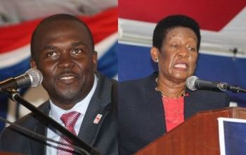 Junior Minister for Trade and Investment Promotion, Hon Marlon A. Penn (R8), left, has been spearheading a series of public meetings hosted by the National Democratic Party (NDP) backbenchers without the Ministers of Government. One such meeting was held in the Fifth District, which is represented by Hon Delores Christopher, right. Photo: VINO/File