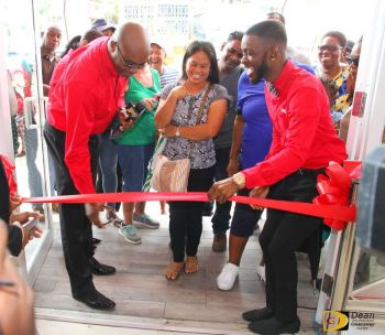 From left: Kevin R. Gordon, then CEO of Digicel, and Andy A. Jeffers, Marketing Executive at Digicel, cutting the ribbon to officially open the doors of the new and improved Digicel flagship store on Waterfront Drive in Road Town on Tuesday, November 21, 2017. Photo: Dean H. Greenaway aka 'The Sportsman'