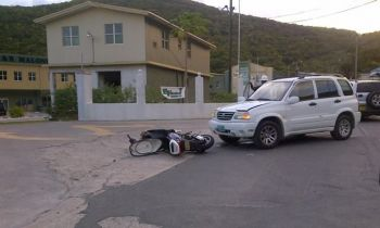 An accident involving a motor scooter and a rental jeep at Pockwood Pond, Tortola on October 2, 2012. Photo: VINO/File