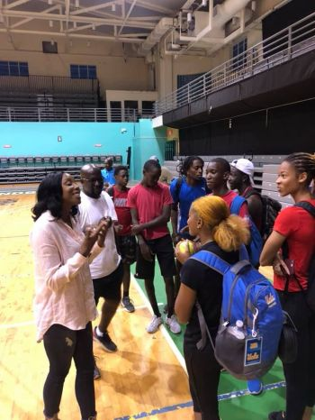 Sherone Simpson, seen here in conversation with young Virgin Islands' athletes, arrived in the Territory on Friday, December 27, 2019. Photo: BVIAA/Facebook