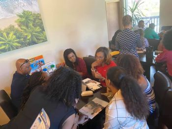 Interim Chairperson of the BVI Chamber of Commerce and Hotel Association (BVICCHA), Shaina M. Smith in discussion with a group of business persons. Photo: BVICCHA/Facebook
