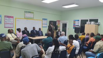 Minister for Education, Culture, Youth Affairs, Fisheries and Agriculture, Dr The Honourable Natalio D. Wheatley (R7) addresses residents of North Sound, Virgin Gorda, at a community meeting on February 6, 2020. Photo: VINO