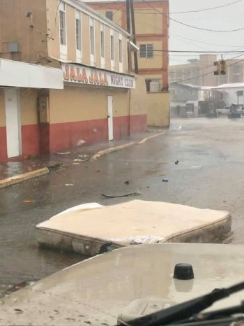 Images from St Thomas, US Virgin Islands, show debris, tree branches and damaged roofs in downtown Charlotte Amalie. A resident, Terence Thomas, told CNN some of the damaged roofs had been covered with blue tarps since Hurricane Maria hit the island two years ago. Photo: Terrence Thomas/CNN