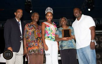 Second from right is East End/Long Look 2013 honouree Ms Juilette Penn with he plaque. She is flanked by the 7th and 8th District Representaives Deputy Premier and Minister for Natural Resouces and Labour Dr the Hon Kedrick D. Pickering, left, and Hon Marlon Penn right. A close relative and Miss EE/LL queen are captured in the moment. Photo: John F. Black