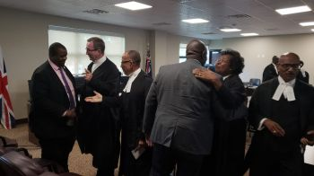 Former Deputy Premier and Minster for Health and Social Development and Member of the Inner Bar, Mrs R. Dancia Penn-Sallah QC greets incumbent Deputy Premier and Minister for Health and Social Development, Hon Carvin Malone (AL) following the Special Sitting for the opening of the New Law Year of the Eastern Caribbean Supreme Court (ECSC) at Sakal Place on Monday, January 13, 2020. Left is Premier and Minister of Finance, Hon Andrew A. Fahie (R1).Photo: VINO