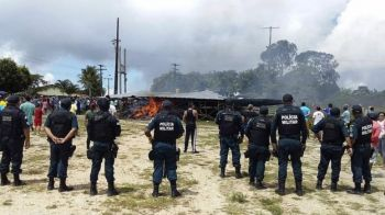 Brazilian police tried to restore control after residents near Pacaraima attacked Venezuelan migrant camps. Photo: EPA