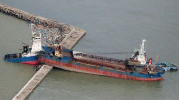 In Hyogo prefecture, the storm caused a ship to crash into a breakwater. Photo: AFP