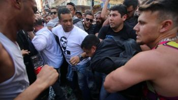 Stabbing suspect Adelio Obispo de Oliveira was grabbed by members of the crowd. Photo: REUTERS