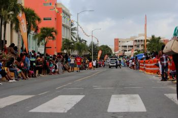 Persons line the roadway along Waterfront Drive awaiting the troupes to pass during the 2015 Festival Parade. Photo: VINO/File