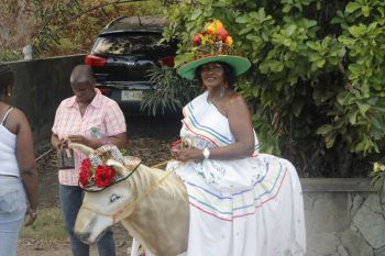 Farmer Moviene F. Fahie and her 'Jack the Donkey' during the parade. Photo: VINO