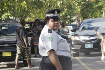 The lone policewoman that had the task of trying to control the traffic for the donkey race. Photo: VINO