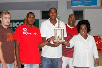 Members of the Bayside Blazers team receive the 2014 Championship Trophy from wife of Hon Julian Fraser RA, Mrs Kharid Fraser. Photo: VINO