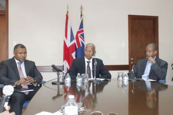 Premier Dr The Hon D. Orlando Smith (centre) accompanied by Financial Secretary Neil M. Smith (right) and Permanent Secretary in the Office of the Premier Broderick Penn, explained that the territory was being measured in its response and was treating the issue very seriously. Photo: VINO
