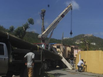 VINLEC team from St Vincent preparing to put up a pole. Photo: VINO