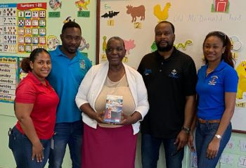 From left: Ms Tracey Graham, Mr Francis Primo, Ms Vansittart C. C. Huggins, Mr Almo George (Owner/Director of Al's Marine Ltd) and Ms Andrea Williams at the presentation of educational supplies to Eslyn Henley Richiez Learning Centre on January 24, 2020. Photo: Team of Reporters