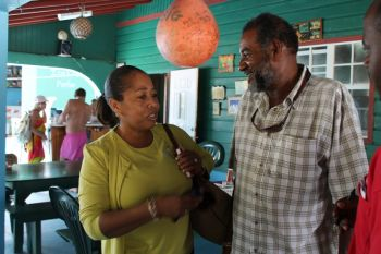 The Proprietor of Big Bamboo, Anegada (right) having his moment with the Tourist Board Director during a guided tour of his guest house. Photo: VINO