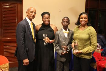 Awardees, L-R, President of the Rotary Club of Tortola Ingrid A. Moses Scatliffe, Jaleel F. Cameron, Gloria A. Fahie and Premier Dr The Hon D. Orlando Smith. Photo: VINO