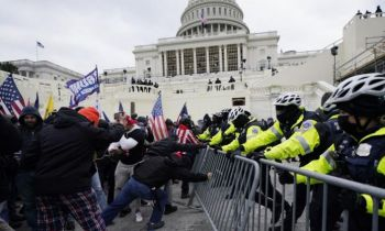 The United States Capitol was put on lock down on Wednesday with lawmakers inside as Donald Trump supporters clashed with police, broke through barricades and entered the building. Photo: Julio Cortez/AP