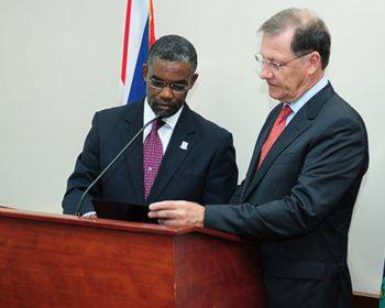 Archibald C. Christian (left) taking his oath as Junior Minister for Tourism on Wednesday December 16, 2015. With him is Governor John S. Duncan OBE. Photo: GIS