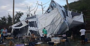 Temporary tent structures set up for students in the West End area that uprooted and damaged by strong winds. Photo: CNS