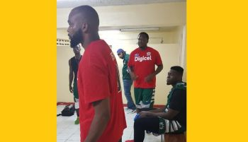 Inside the BVI Bayside Blazers dressing room: Left is Adrian D. Joseph, centre is Jason A. Edwin, right, sitting is Kleon C. Penn and in background, with cap, is head coach Ronald Simmons aka 'Gola'. Photo: VINOBVI Bayside Blazers celebrate their win against St Eustatius (Statia) at the 6th annual 'Battle of the Fittest' Basketball Tournament in Philipsburg, St Maarten on July 16, 2019. Right is team captain Jason A. Edwin. Left (#20) is his brother Deon J. Edwin. Photo: VINO
