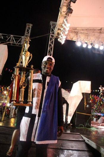 B'More with his large trophy after taking second at the 2016 Soca Monarch BVI, Caribbean Edition. Photo: VINO