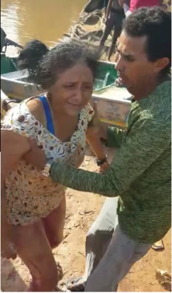 A screen shot of the dead miner's mother on the Puruni Landing being consoled by her husband. Photo: KN