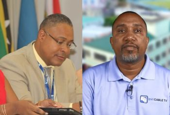 General Manager of the BVI Electricity Corporation (BVIEC) Mr Leroy A. E. Abraham, left, and CEO of BVI Cable TV Mr Romney Averad Penn. Photo: VINO/Facebook