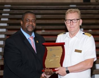 Premier Andrew A. Fahie presents a plaque on behalf of the Government and people of the Virgin Islands to the captain of the Viking Sun, Atle Knutsen. Photo: Facebook/GIS