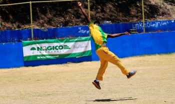 A Jamrock player flies for a catch in the outfield against Vikings. Photo: supplied