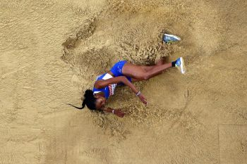 Chantel E. Malone leaps into the sand at the 2017 IAAF World Athletic Championships. Photo: zimbio