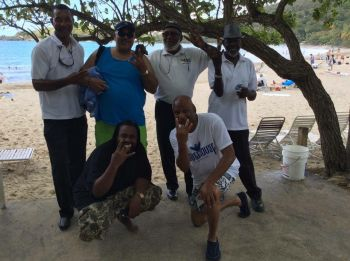 Kervin C. Rymer spreading the joys of being a Virgin Islander with tourists and some local taxi drivers. Photo: Provided