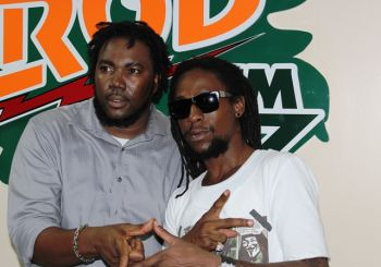 Jah Cure strikes a pose with dj and promoter Paul 'Gadiethz' Peart. Photo:VINO