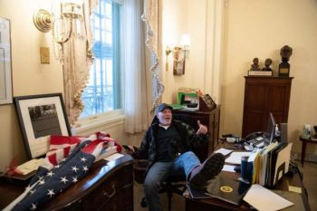 A pro-Trump protester is pictured making himself at home in the office of House Speaker Nancy P. Pelosi. Photo: Getty Images