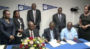 Officials from the Government of St. Kitts and Nevis, the Ministry of Education, the Clarence Fitzroy Bryant College (CFBC) and the University of the Virgin Islands (UVI) sign the Memorandum of Understanding in July 2013. Photo: CUOPM