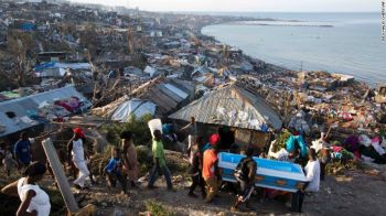 In Jeremie, Haiti, Hurricane Matthew claimed the life of a pregnant woman, whose remains were carried in a coffin by local residents on Friday, October 7, 2016. Photo: www.aljazeera.com
