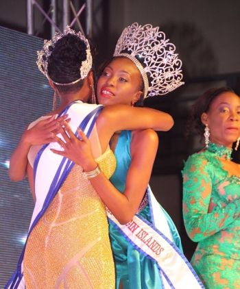 Creque is given a congratulatory hug by Miss BVI 2015/16 Adorya R. Baly (right). Photo: VINO