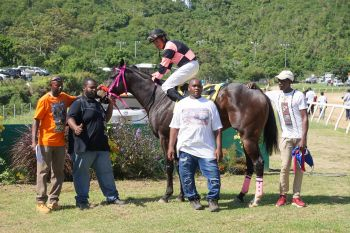 Uncle Mace of Top Priority Racing Stables in the winner's circle. Photo: Andre S. Dawson aka 'Shadow'