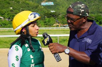 Winning female jockey Cindy Soto, left, is interviewed by Andre Dawson aka 'Shadow' after taking victory on Flashing Cat in a one-mile race for mares and fillies. Photo: Photo: Andre S. Dawson aka 'Shadow'