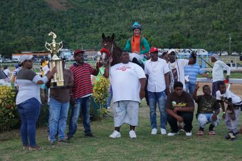 Courage & Honour, with jockey Nick Goodman, won the feature race of the Pre-Valentine's Horse Races at Ellis Thomas Downs in Sea Cows Bay on Sunday, February 2, 2020. Photo: Andre S. Dawson aka 'Shadow'
