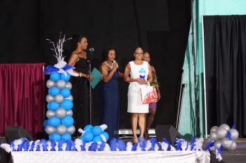 At the end of the show, Mrs British Virgin Islands 2000 Pearline Williams-Vergeer presented reigning Mrs British Virgin Islands Shevone A. Findlay with her prized package, which included a smart phone from Digicel, official trophy and flowers by Bella Bloom Florists. Also included are trips to the Mrs Globe and Mrs World pageants to represent the BVI in a wardrobe designed by Unlimited by Jermaine and pieces from Beautiful by Jasanay. Photo: Stephen A. McMaster