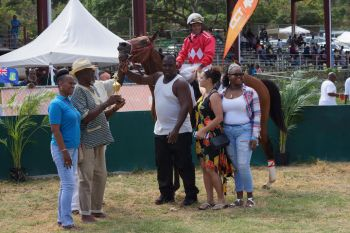Virgin Islands cultural icon, Feliciano (Foxy) Callwood OBE presented the winning trophy to The Boys Stables. Photo: Andre 'Shadow' Dawson/VINO