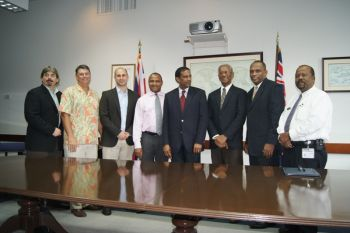 In happier times: This VINO photo was taken following the signing of a Heads of Understanding (HoU) between Government and Tortola Port Partners (TPP) on March 27, 2012 in the conference room of the Premier's Office. Minister for Communications and Works Hon Mark H. Vanterpool (2nd from right) had said the HoU gave both parties the terms of understanding to negotiate a way forward over the next 90 days before the plans for the expansion of the cruise ship pier, development of the land side and improvements to Road Town are brought to the public for discussion and input. Tortola Port Partners Limited is a joint venture of the Jay Cashman Group and the United Infrastructure Group (UIG) with the participating cruise line being Disney. Disney Cruise Line was represented by Mr Hugh E. Darley (2nd from left), President of IDEA Inc, which is a subsidiary of the UIG Company. The actual plans, then estimated to cost $75M, was brought to the public on June 27, 2012. Photo: VINO/File