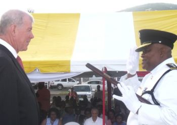 The late Richard D. Holder (right), seen here receiving the Second Clasp to the Police Long Service Medal for 30 years of service from Governor Boyd McCleary at the Queen's Birthday Parade in 2011, was laid to rest on December 19, 2012. The cause of his death is yet not officially known. Photo: VINO/File