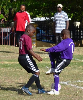 Andre Smickle scored twice for Althea Scatliffe to secure a 2-0 victory against Enid Scatliffe Orange. Photo credit: Charlie E. Jackson/VINO