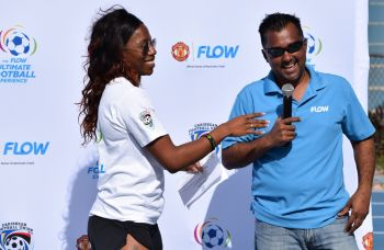 The Virgin Islands (VI) top sprinter, Ashley N. Kelly (left) with FLOW's Commercial Manager, Ravindra Maywahlall. Photo: Charlie E. Jackson/VINO